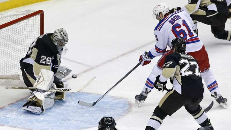 Pittsburgh Penguins goalie Marc-Andre Fleury (29) stops a