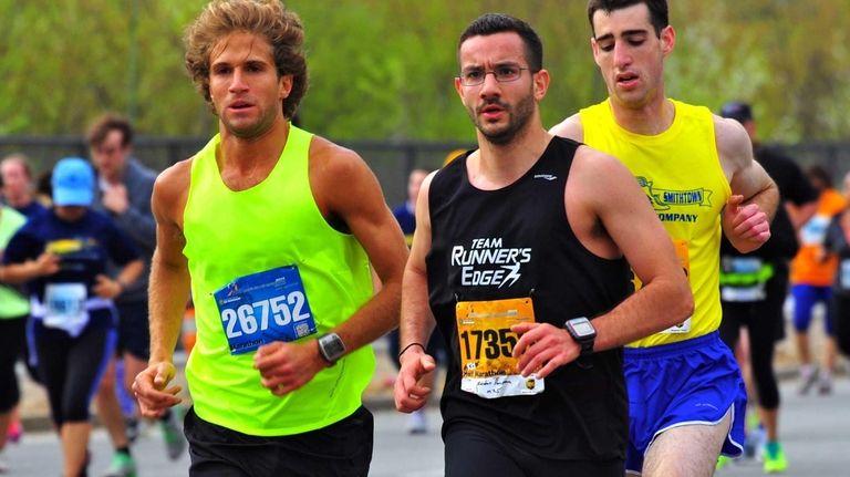 From left, marathon champion William Schefer, half-marathon third-place