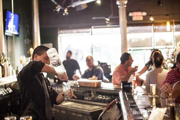 A bartender mixes drinks at Toro Pazzo in