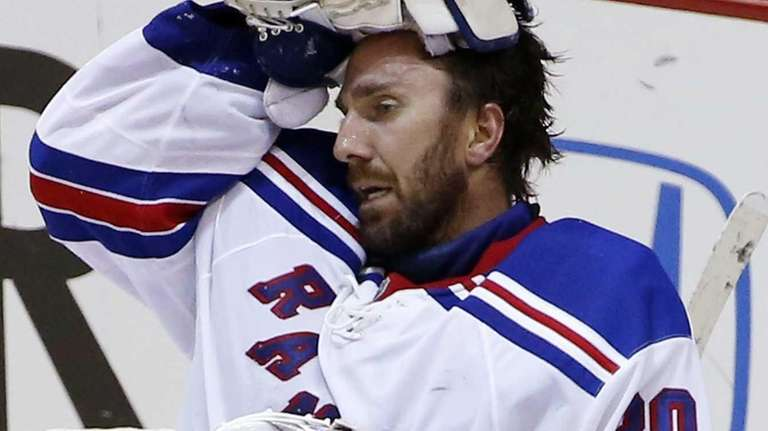Henrik Lundqvist (30) collects himself after allowing a