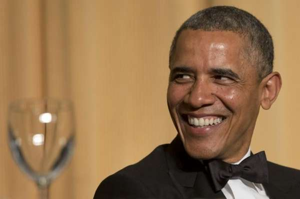 President Barack Obama laughs as actor and comedian