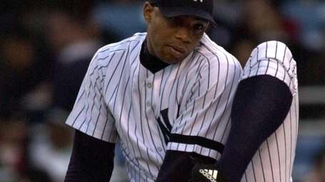 Yankees pitcher Orlando Hernandez winds up as he
