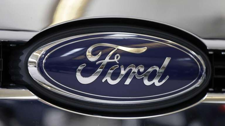 The Ford logo on the grill of a