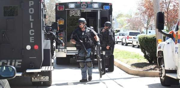 Emergency personnel work a possible hostage situation after