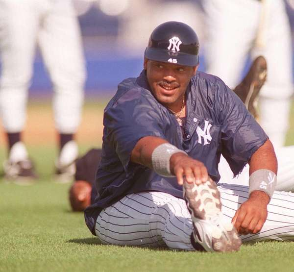 Yankees' Cecil Fielder stretches during spring training in