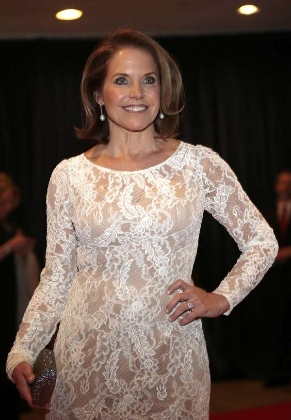 Television journalist Katie Couric arrives for the White