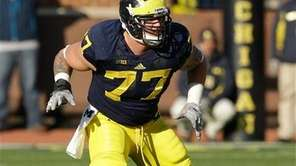 Michigan offensive linesman Taylor Lewan (77) is seen