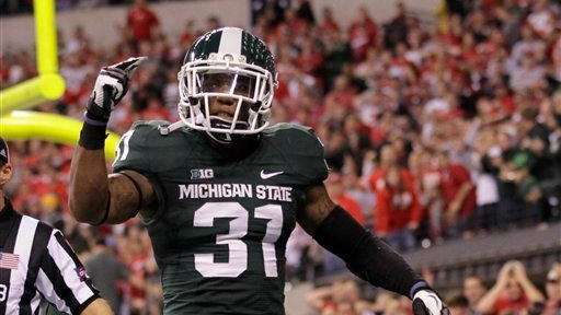 Michigan State's Darqueze Dennard (31) reacts during the