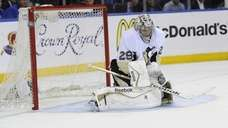 Pittsburgh Penguins goalie Marc-Andre Fleury deflects the puck