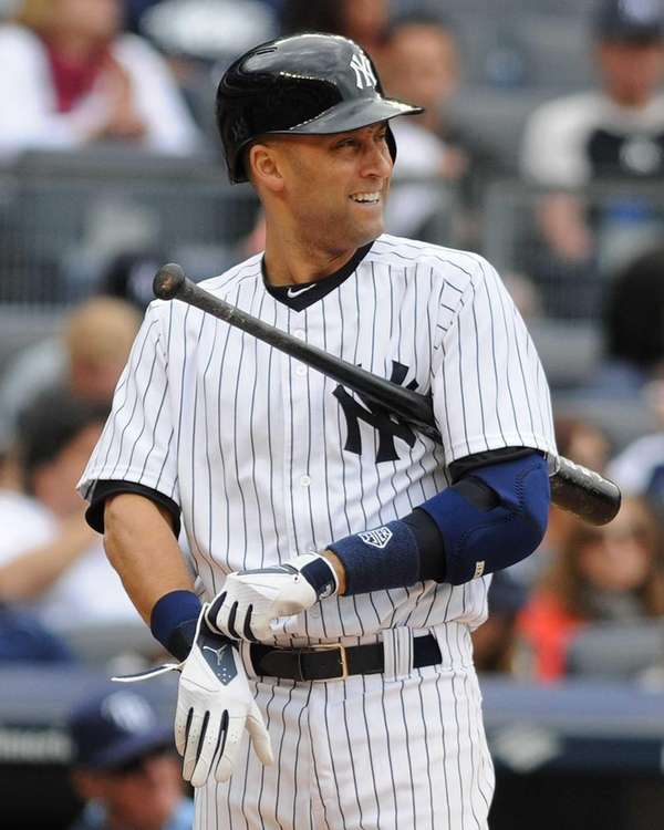 Derek Jeter adjusts his batting gloves as he