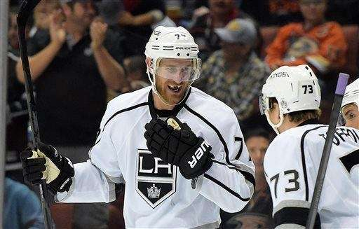 Los Angeles Kings center Jeff Carter, left, smiles