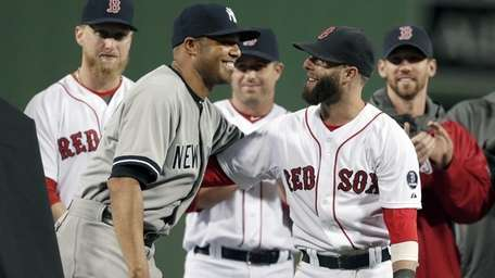 Yankees relief pitcher Mariano Rivera, left, embraces Boston