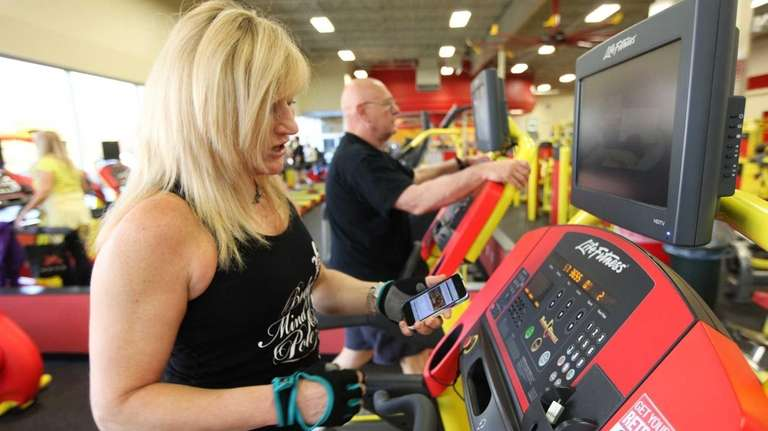Tracy Levy of North Bellmore uses her smartphone