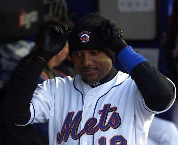 Darryl Hamilton pulls on a stocking cap and