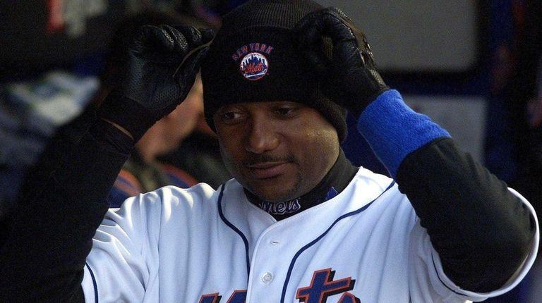 Darryl Hamilton pulls on a stocking cap and