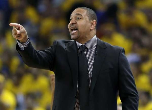 Golden State Warriors head coach Mark Jackson instructs