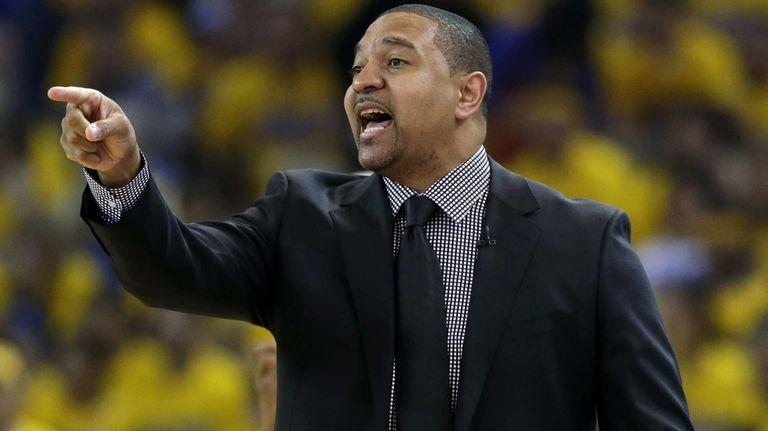 Golden State Warriors head coach Mark Jackson instructs
