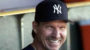 The Yankees' Randy Johnson laughs in the dugout