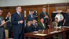 Four defendants were arraigned on May 6, 2014,