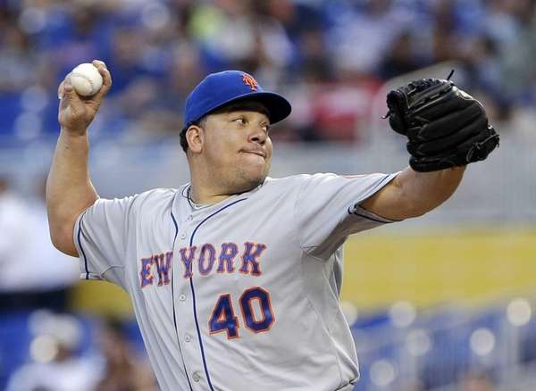 Bartolo Colon delivers a pitch during the first