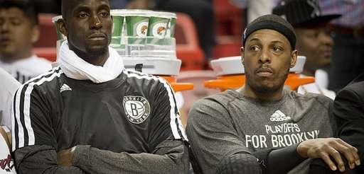 Nets' Kevin Garnett and Paul Pierce watch in