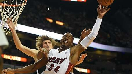 Miami Heat's Ray Allen is fouled on a