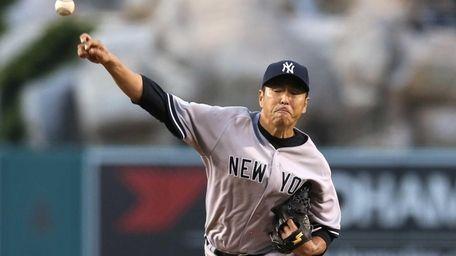 Hiroki Kuroda of the Yankees throws a pitch