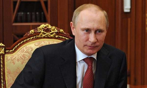 Russia's President Vladimir Putin attends a meeting in