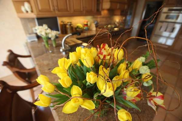 Mixed tulips in a kitchen.