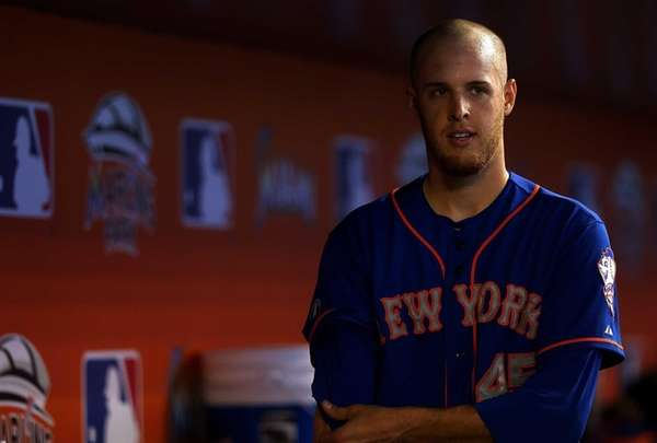 Zack Wheeler looks on during a game against