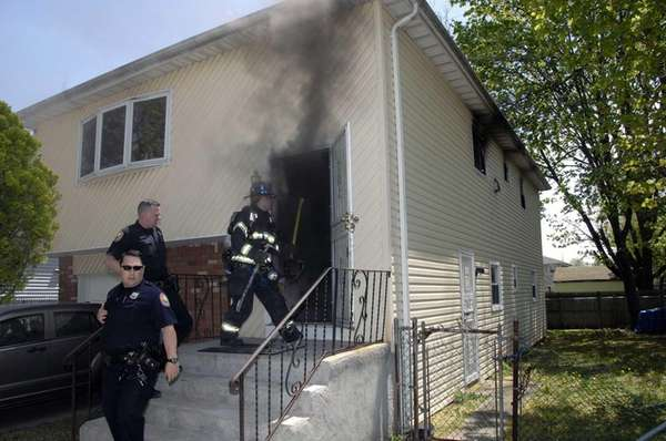 Firefighters work on a blaze in a house