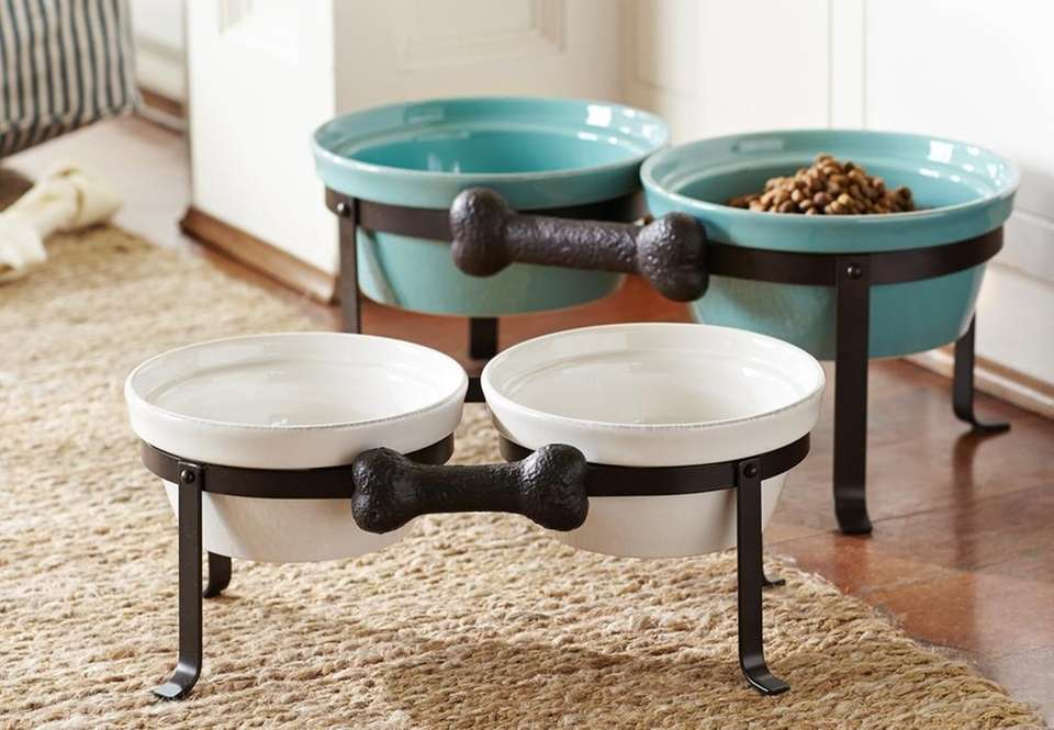 Glazed stoneware bowls placed in a cast-iron stand