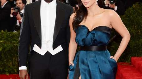 Kanye West and Kim Kardashian attend the