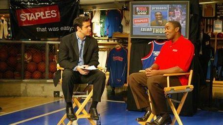 Isiah Thomas, right, speaks with NBA anchor Spero