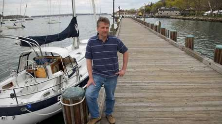 Newly-elected Northport trustee Ian Milligan stands on the