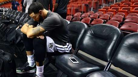 Brooklyn Nets' Deron Williams sitting alone before the