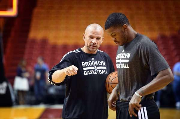 Jason Kidd talks with Joe Johnson during a