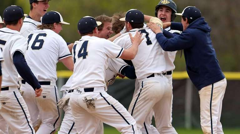 Bayport's Jack Piekos is mobbed by his teammates