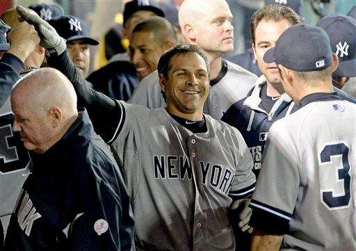 Brian Roberts is greeted in the dugout after