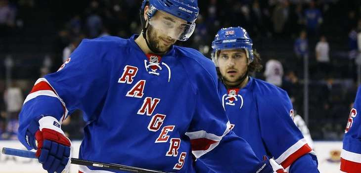 Derick Brassard and Mats Zuccarello skate off the