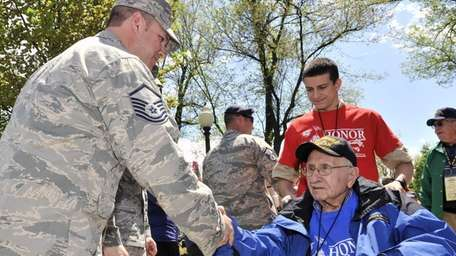 Santo Squillacioti, 93, of Smithtown, is greeted by