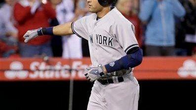 Derek Jeter celebrates a home run against the