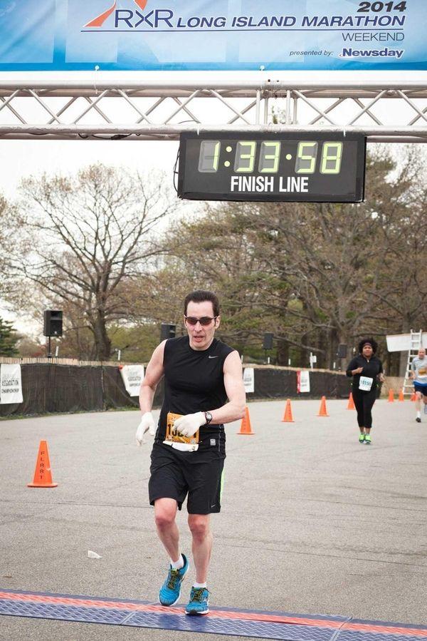 John Hanc crosses the finish line of the