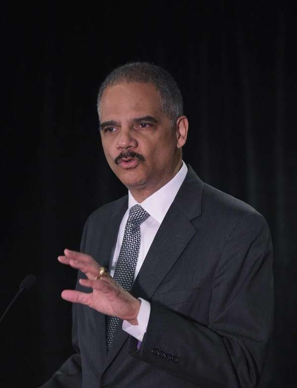 Attorney Eric Holder delivers the keynote address at