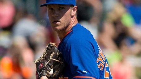 Noah Syndergaard #55 of the Mets looks toward