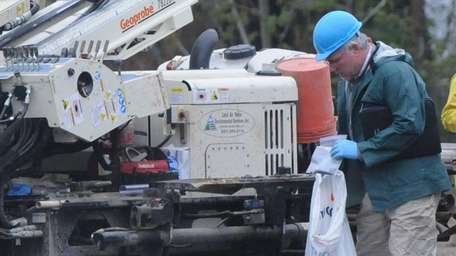 A worker from the state Department of Environmental