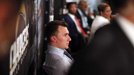 Johnny Manziel, from Texas A&M, waits backstage during