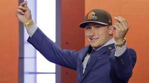 Texas A&M quarterback Johnny Manziel reacts after being