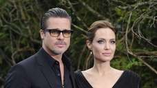 Angelina Jolie and Brad Pitt arrive for a