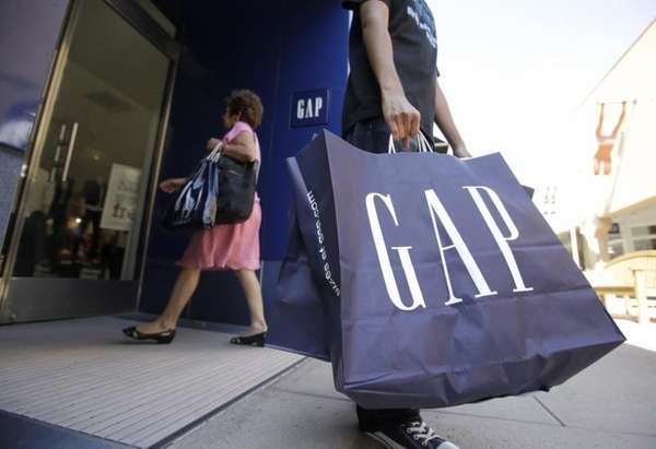 A shopper leaves a Gap store in Palo